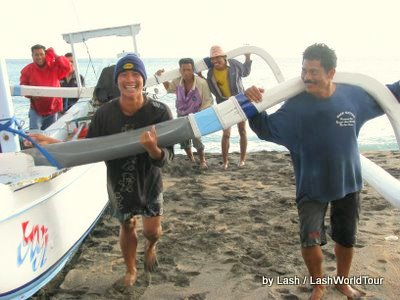 fishermen returning jukung to beach- Amed- Bali