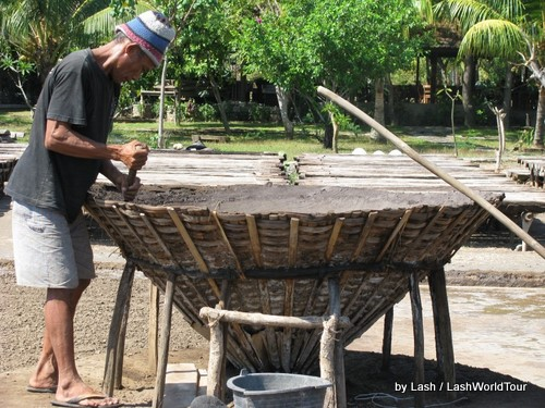 man making salt- Amed- Bali