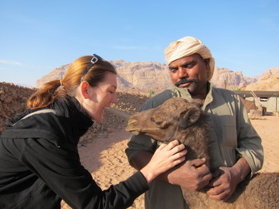 travel interview- Shannon Bonding with a baby camel, Wadi Rum, Jordan