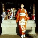 Lash in orange kimono at Kitano Tenmangu Shrine, Kyoto, Japan