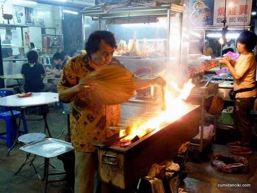 street stalls in Malaysia- the satay man