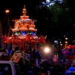 Thaipusam's silver chariot illuminated at night