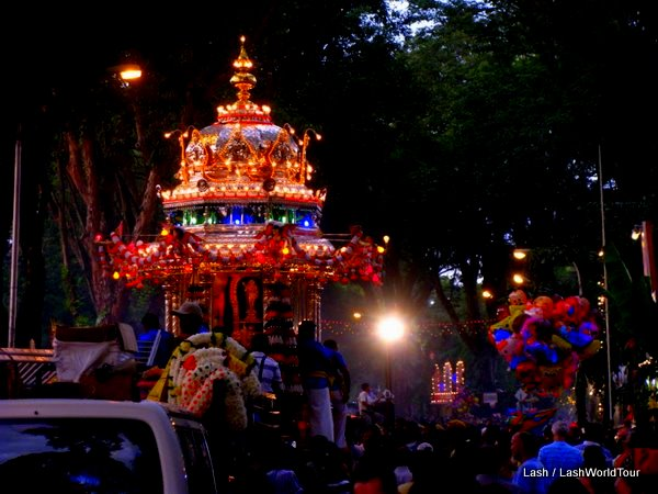 Thaipusam's silver chariot illuminated at night