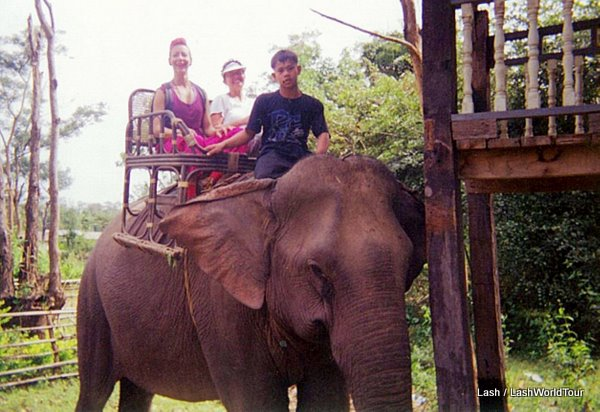 Lash riding elephant in Laos