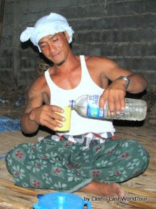 Balinese guy pouring arak
