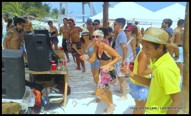 dancing at a Sunday rave party on Tulum Beach