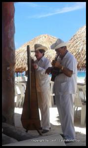 Traditional Mexican musicians on Puerto Morelos Beach - Mexico