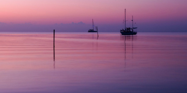 Calm Belize sunset over sea in lavender