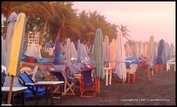 rows of beach umbrellas at sunset - Cuyutlan