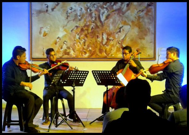 classical orchestra performance at Casa de Tres Mundos